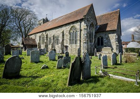 Church of St George and graveyard Brede Kent UK