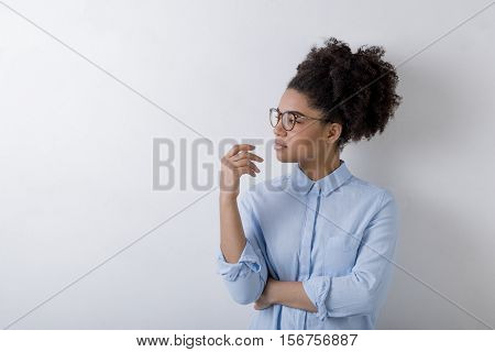 Business woman deep in thought looking away with hand under chin