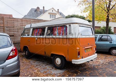 STRASBOURG FRANCE - NOV 6 2016: Classic white and orange Volkswagen Camper (Type 2) van parked in city environment. The Volkswagen Type 2 known officially (depending on body type) as the Transporter Kombi or Microbus or informally as the Bus (US) or Campe
