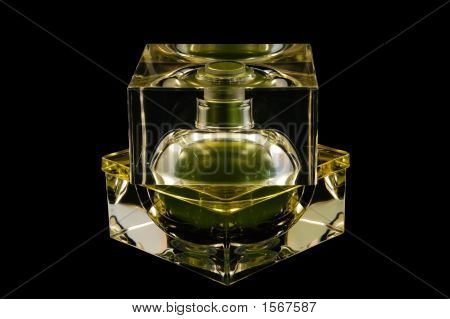 Bottle Of Perfume Over Black Background
