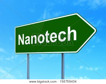 Science concept: Nanotech on green road highway sign, clear blue sky background, 3D rendering