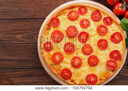 Fresh tasty pizza Margarita and tomatoes, top view