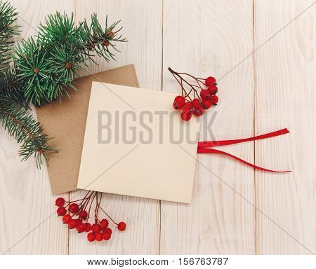 Christmas mokup.Tree branch frame empty cards with rowanberry .White wooden table.Top view