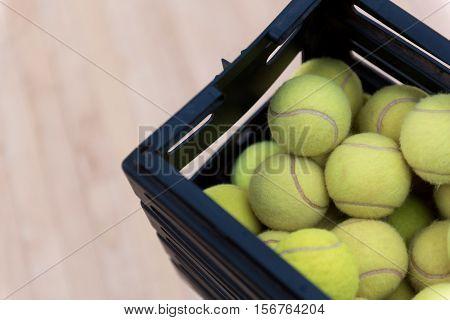 Get prepared. Close up of teenis balls lying in box