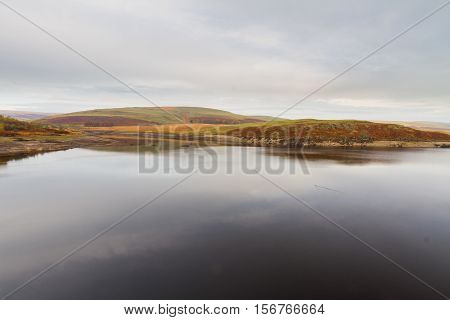 The Claerwen Reservoir part of Elan Valley Reservoirs on a still Autumn Fall morning. Powys Wales United Kingdom.