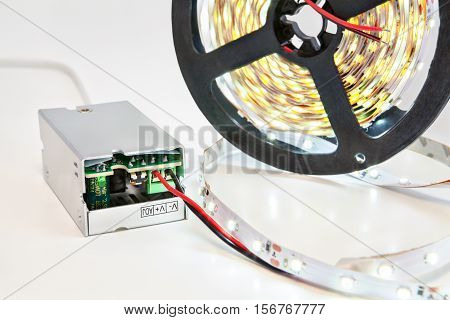 Close-up reel with LED strips with included light and Power Supply Adapter Driver.