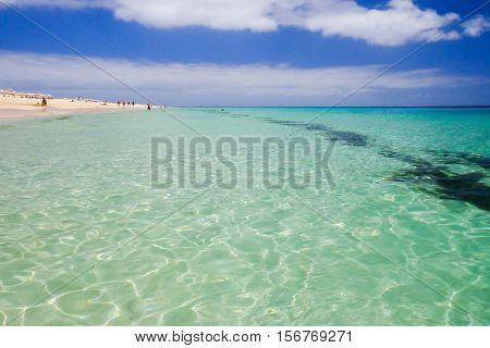 View on the beach Playa de Morro Jable and Atlantic ocean on the Canary island Fuerteventura Spain.