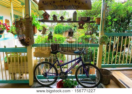 SALENTO COLOMBIA - JUNE 6: Bicycle under welcome sign in a lush green garden in Salento Colombia on June 6 2016