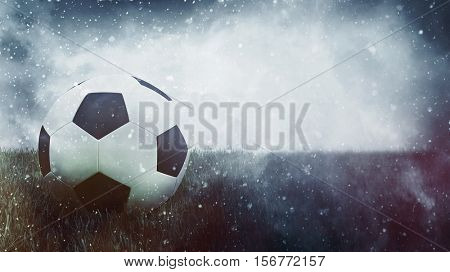 3d Rendering. Single soccer ball in grass as winter theme grunge sports background with copy space