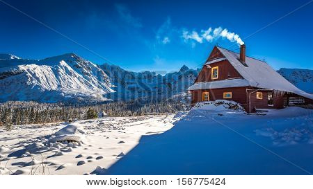 Warm Cottage In Winter Mountain Day In Poland