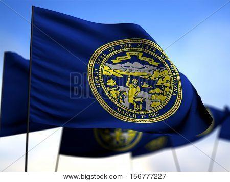 flags of Nebraska on blue sky background 3D