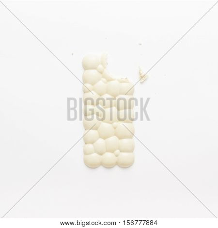 nibbled chocolate bar on the white background. not isolated