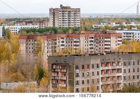 Pripyat city exclusion zone from the high empty abandoned building. Autumn time. Chernobyl, Ukraine.
