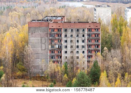 Abandoned town Pripyat in Chernobyl's area Ukraine. Exclusion zone from the high empty abandoned building.