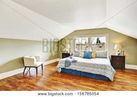 Spacious Upstairs Bedroom With Vaulted Ceiling And Hardwood Floor