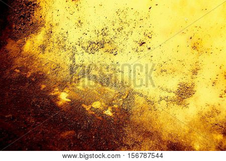 Gold grunge metal background with weathered rust pattern.