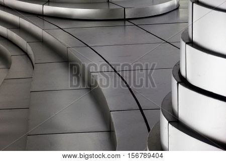 Silver colored steps and pillars architectural design background in horizontal 3:2 format.