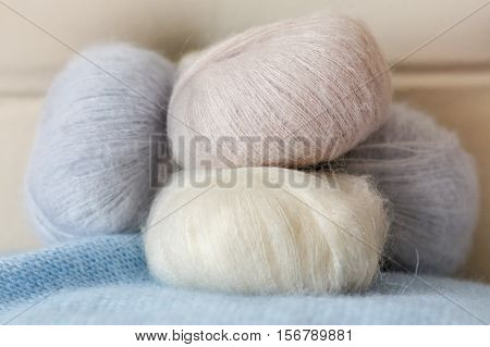 Thin Fluffy Skeins Of Wool For Knitting A Pale Pink, Blue And Beige Colors