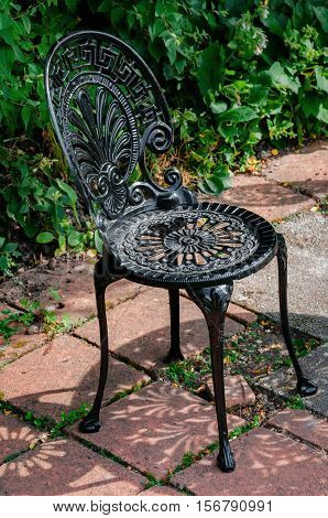 Wrought cast iron chair in the garden black color