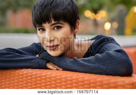 Attractive young woman with short stylish hair and friendly smile