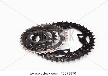 Three bicycle chainwheels and chainring on a white background