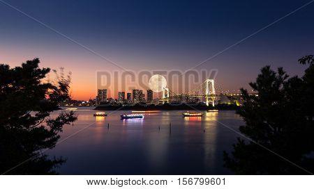 Rainbow bridge and Tokyo bay Odaiba Japan. Full moon