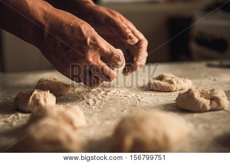 homemade cakes of the dough in the women's hands. The process of making pie dough by hand