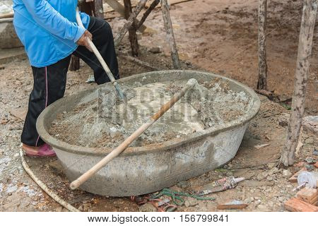 Worker working with cement mixer in construction site,Mixing cement for the preparation in construction site.