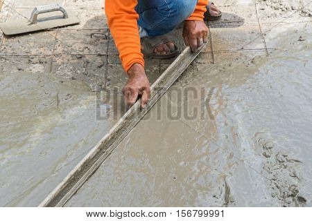 Workman plaster at construction site,Concrete pouring during commercial concreting floors of buildings in construction(Commercial Building)