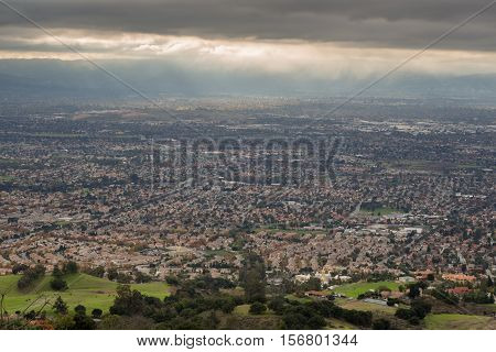 Aerial View of the Silicon Valley, Green Countryside and Dark Cloudy Sky.