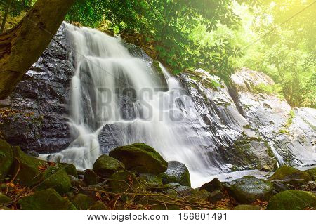 relaxing at Ton Nga Chang waterfall with sunlight National park in Hat Yai district Songkhla province Thailand