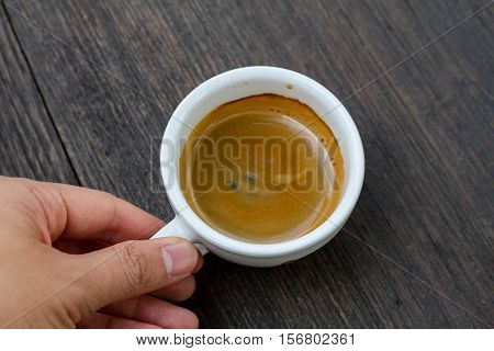 Espresso double shot on wood background vintage tone shallow depth of field
