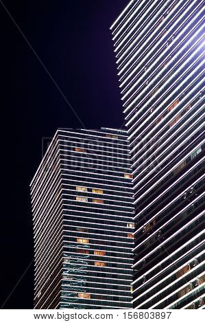 Modern the high-rise buildings with lights in the windows at night. Astana. Kazakhstan
