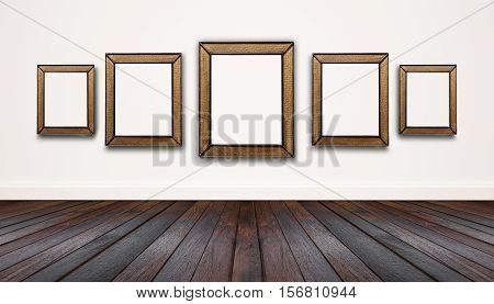 Hardwood floor with white wall, and blank picture frames on wall