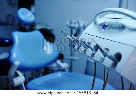 Modern dental equipment close up on a background of blue dental chair