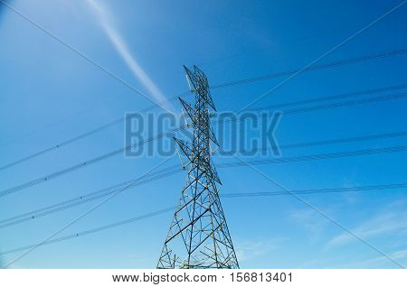 High voltage pole.Pole and high voltage transmission lines outdoors.