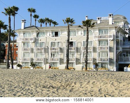 Santa Monica USA June 14 2011: big white house on the beach in Santa Monica. People take a walk and go footing