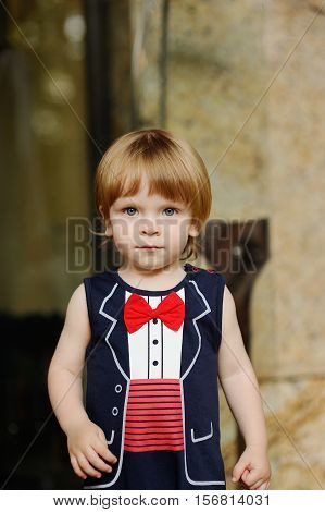 cute baby with red hair in a red bow tie