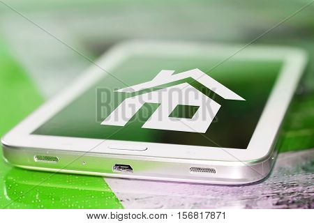 A house symbol on the cell phone screen . The concept of the home page of the Internet .