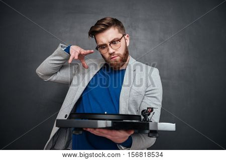 Hipster with vynil. isolated black background