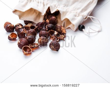 Soap Nuts On A White Background Poured From The Bag. Care Products. Natural, Organic