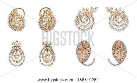 Collection of Pairs of diamond earrings with diamonds and pearls isolated over black background