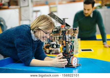Robotics engineer young students teamwork on project