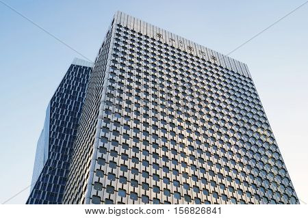 PARIS FRANCE - SEPTEMBER 29 2015: Tour Ariane is an office skyscraper located in La Defense business district in Paris France