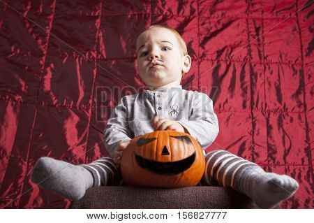 Portrait of a little boy dress up for halloween party. He has a serious suspecting expression