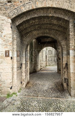 The entry to the castle Scaliger in old town Sirmione on lake Lago di Garda. Italy