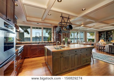 Large Kitchen Island With Hanging Pot Rack Above