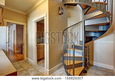 Small Hallway Interior With Spiral Metal Staircase