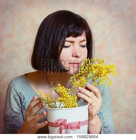 happy mother with mimosa flowers presented on womans day