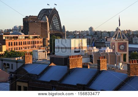 Sydney Australia - October 24 2016: Urban view of old buildings rooftops at the historical area The Rocks with Sydney Harbour Bridge in the background in Sydney city center Australia.